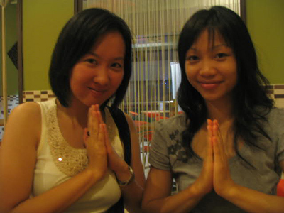 Fiona and Tina waiing. We were at Mango cafe, a Thai restaurant in KK.