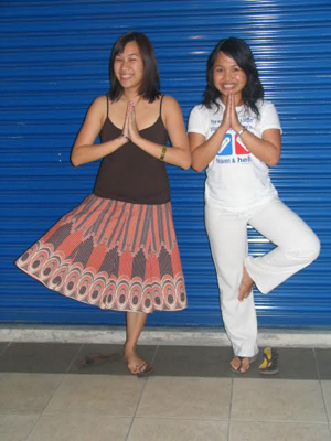 Tree pose by yours truly and Julie ehehe. Uhm yeah I really like my skirt.